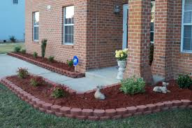 Decorative Stones For Flower Beds Flower Bed Against Brick Wall Flowers Ideas