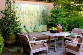 light brown round contemporary wooden small space patio furniture varnished ideas for patio table and chairs with jar and apples