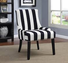 black and white striped accent chair on pottery barn area carpet in blue room