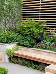 plant shade loving perennials under garden bench this secluded part of the garden features shade loving perennials planted under a garden bench that adds