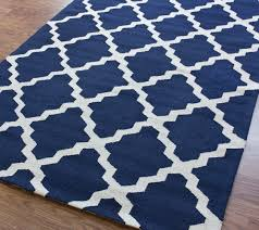 contemporary style interior navy blue nuloom area rugs geometric shapes quatrefoil pattern natural finish red oak flooring hand tufted wool white and