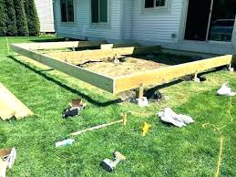 floating deck over concrete patio building a on