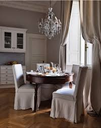 source stefania di girolamo chic european dining room with gray walls paint color and elaborate crown molding millwork soft gray linen curtains window