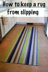 how to keep throw rugs from sliding on carpet small rug sliding how to keep rugs