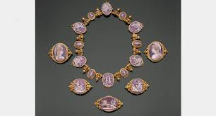 this necklace and set of five brooches are part of the permanent collection of the museum