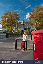 Designer Post Box Cobham High Street Surrey Post Box Female Shopper With