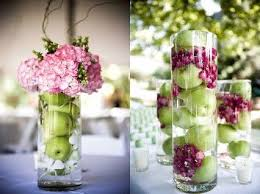 fruit and flower arrangements - apples in water with flowers. Use lemons,  small oranges, cranberries, cherries or any other fruit&flower combination  you'd ...