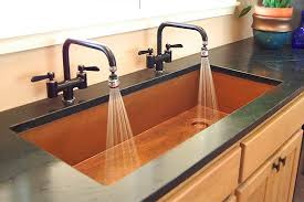 the art of the sink tough yet malleable copper is a statement metal that readily accepts hand tooled finishes and embossed designs it develops a rich
