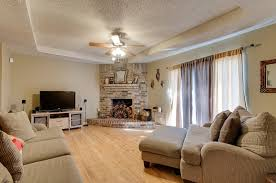 contemporary living room with old style brick corner fireplace
