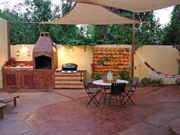 rustic brick patio with built in grill