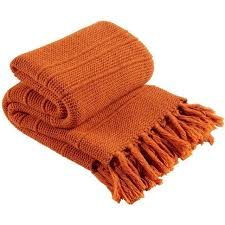 this is a product shot of christy agnes throw rust