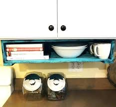 lovely under kitchen cabinet storage apt e rack organizer cupboard shelves