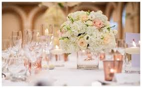 Low wedding flowers table centrepieces