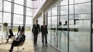 corporate office lobby. Delighful Lobby Businessmen Talking Walking Lobby Corporate Office Building U2014 Stock Video For
