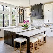 painted kitchen cabinets in sherwin williams sw 7005 pure white black island and range hood