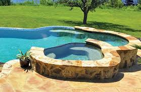 inground pools with waterfalls and hot tubs. Freeform-concrete-pool-spa-wtih-flagstone.jpg Inground Pools With Waterfalls And Hot Tubs