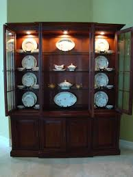 Found this helping a friend.good tutorial on how to set up your china  cabinet. If you can overlook the lace and junk. But the concept is good.