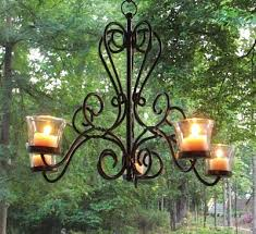 even a traditional wrought iron chandelier can be an outdoor lighting source this piece is best tucked beneath a covered patio
