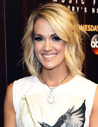carrie underwood goes without makeup in gym selfie photo