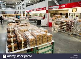 bulk in a supermarket stock photos bulk in a supermarket stock customers shopping in the bakery section of a costco whole warehouse club stock image