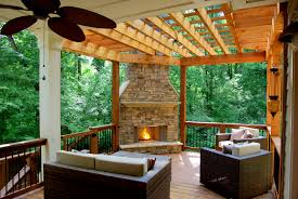 why you should add an outdoor fireplace or pit to your deck patio with outdoor