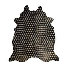 arlequin cow hide rug black gold by amigos de hoy