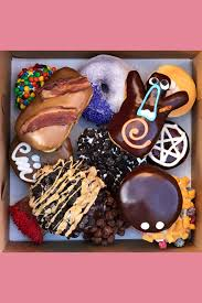 a top down view of a dozen doughnuts from the flyer fryer sticker sheet including a