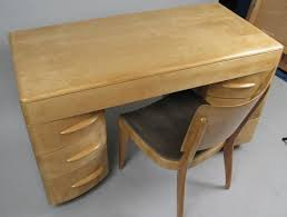 a classic kneehole desk in solid birch made in the 1950s by heywood wakefield along