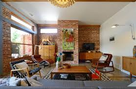 painting brick fireplace for a midcentury living room with a red brick and mid century modern family home situated one metre from workamy houzz connecting