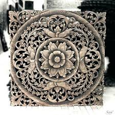 white carved wood wall art