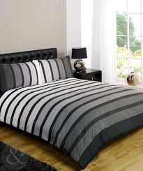 bedroom window treatments and grey duvet cover with black headboard