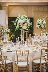 white gold green wedding ideas elegant wedding inspiration tall wedding centerpieces photo steve lee photography flowers decor dream bouquet