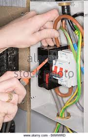 fuse wire stock photos fuse wire stock images alamy an electrician fixing a fuse box stock image