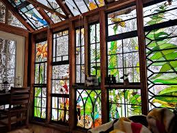 neile cooper glass cabin stained glass cabin repurposed windows repurposed building materials