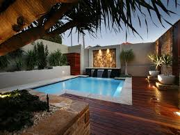 swimming pool lighting options. Backyad Lighting Options In Small Pool And Wooden Deck Near Two Big White Plant Pots Swimming