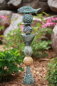 laurie landry pottery ceramic totems garden totem not poly clay but you could do it with a small one say in a pot