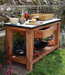 garden kitchen with stone top and sink