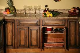 rustic pecan kitchen base cabinet with granite top