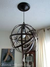 astonishing crystal orb chandelier foucault s orb crystal iron 6 light chandelier round dark brown