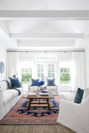 red and blue vintage rug with white accent chairs