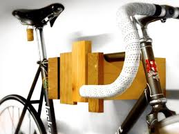 cantilever and press wall mount bike storage rack resembles a wooden xylophone