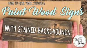 how to seal vinyl stencils paint wood signs with stained backgrounds