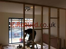 carpenters building wood structure partition wall