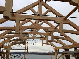 under construction great room timber trusses with custom made steel hardware
