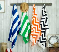Image Bedroom Four Zigzag Print Beach Towels Hanging Off Hooks Next To Each Other Simba Towels Everyone Needs These Four Types Of Towels Simba Blog