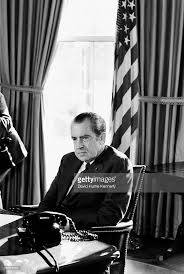 nixon office. president richard nixon sits at his desk in the oval office of white house