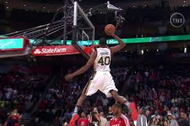 jeremy evans was appaly saving all his best dunks for the end after completing a dunk over a painting of himself evans one upped that with a scissor