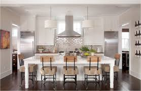 transitional kitchen white drum shade chandelier lights fixture dark brown oak hardwood flooring island overhang table glass subway tile backsplash polish