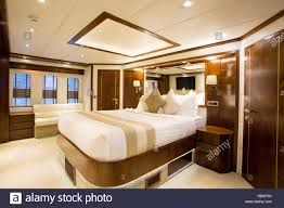 Sleeping Quarters Or Bedroom Of A Luxury Yacht Ship Stock Photo