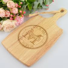 engraved wooden cheese paddle board